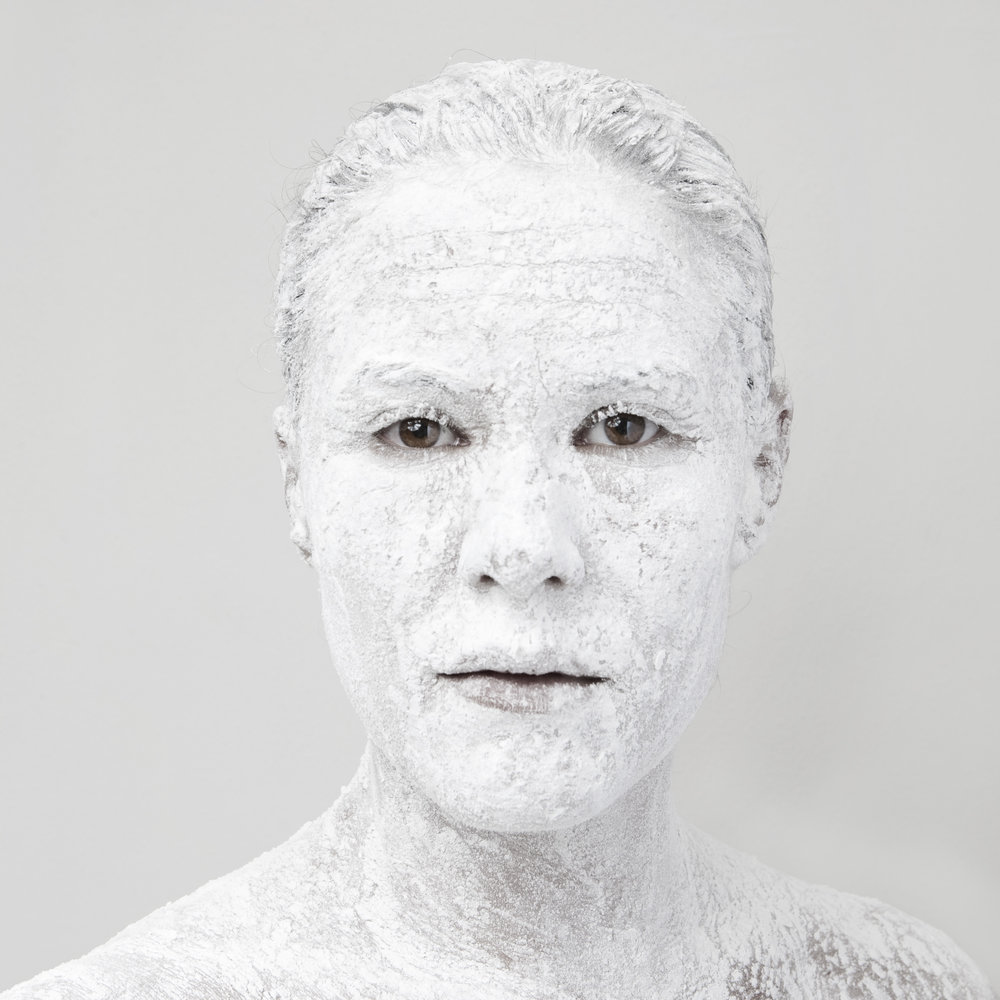 Project 1, attempt 3, series called Flour, this is #3, a self-portrait, this was shot as part of a 8 week clinic I participated in, 3 years after graduating. This was the series that ended it all, this image is my favorite image i have created. Technically executed to validate my need to praised for education. Creative enough to satisfy my urge to dazzle. Direct into the lens like a mirror, reflecting back confidence and freedom.   Cameras are mirrors reflecting back what a object and creator are collaborating. The connection to subject is only as strong as the collaboration. Subject matter is always light and mood. creators and objects move within the subject. I decided what you see.