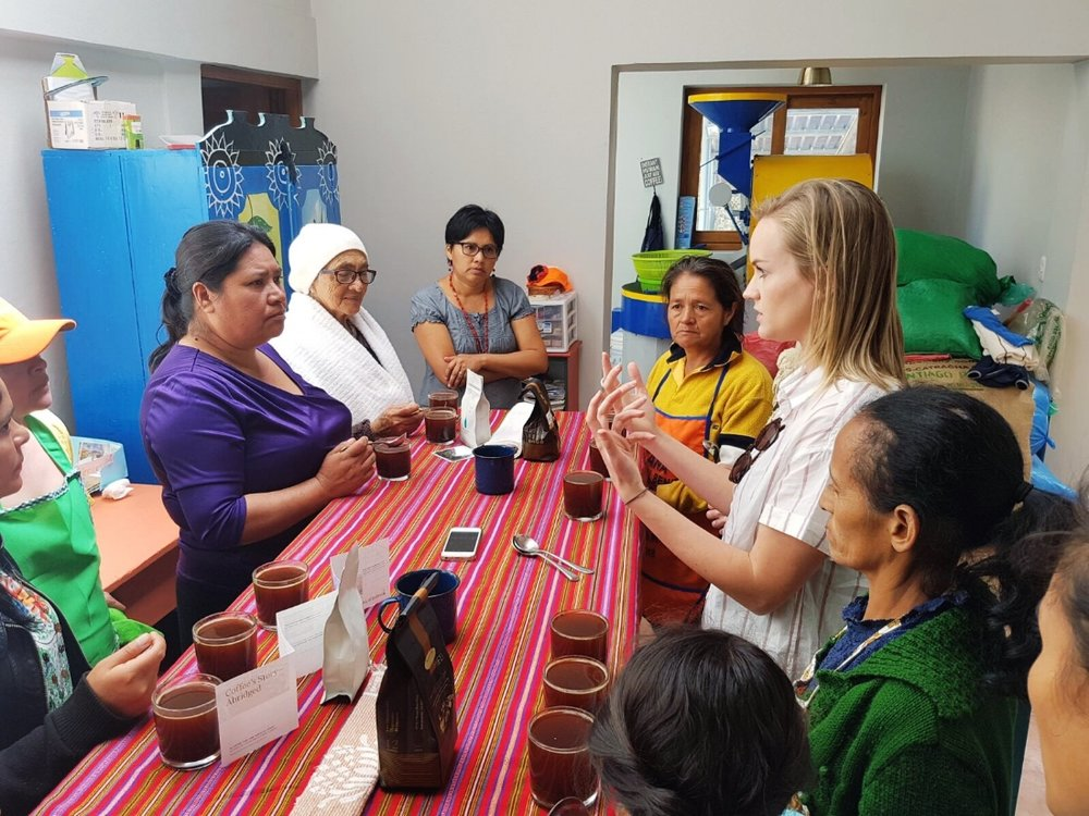 Carly cups Blue Bottle coffees with women farmers from Santa Elena.