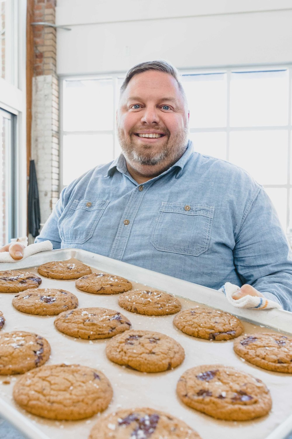 Culinary Operations Manager David Hurt with a fresh-baked tray of our Chocolate Chip Cookies