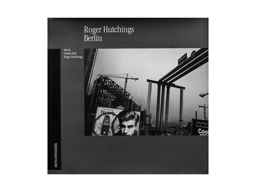 """Berlin - Published by Federico Motta 1999 with a foreword by Grazia Neri .ISBN 88-7179-227-0""""The best way to know a city is to walk through the city streets without prejudice, leaving at home the tourist guides and discarding other people's ideas, trying to use our own minds and our own emotional visions, pursuing our own personal research and not accepting the recollection of a deja-vu.This is the spirit with which Roger Hutchings visited BerlinThe light of these pictures is the one of Wim Wenders movies but with a more morbid density and a harder and closer cut to the images; only the sky light seems to put a veil of poetry and feeling on this city that is trying to find a balance between East and West, and Past and Present"""""""