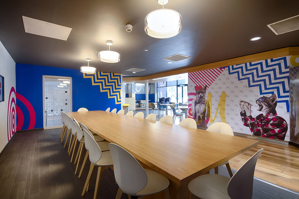 Dining area with bold bright wall graphics