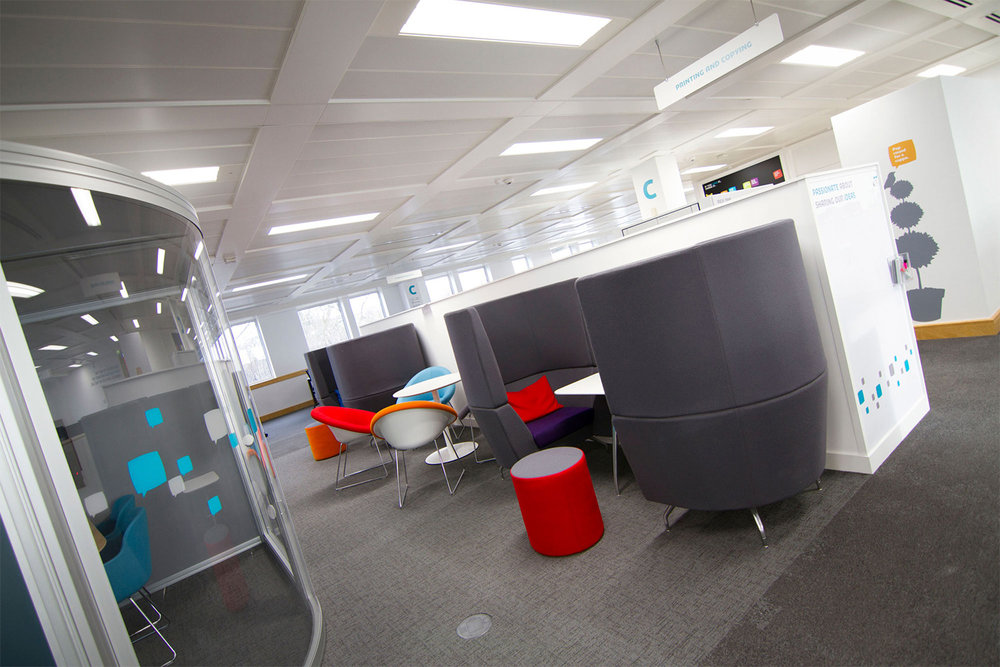 Breakout booths and meeting pods with glazing manifestation in red, grey and blue