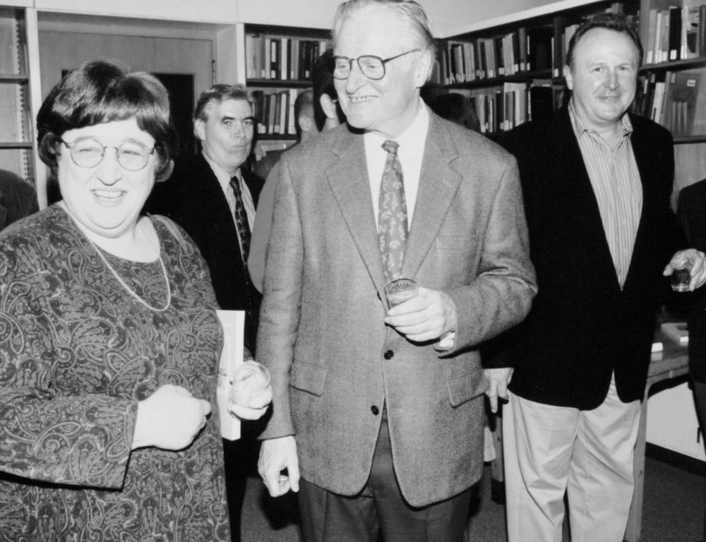 John Ashbery's 70th birthday celebration at the Poetry Room in 1997, with Prof. Helen Vendler (left) and the late Bill Corbett (right). Courtesy of the Woodberry Poetry Room, Harvard University.