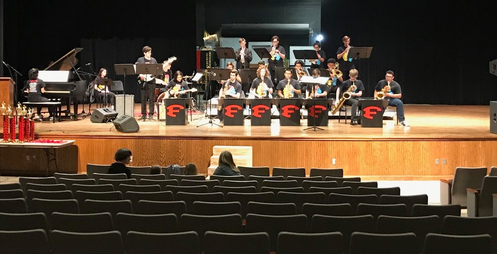 "World Premiere of Tom Kubis's ""Bluzin' Burg""!!! - The Fredericksburg High School Jazz Ensemble commissioned World famous Big Band Composer and Arranger Tom Kubis to write a piece for the group. Performance was a huge success and students were surprised to receive personalized, autographed parts from Tom Kubis himself immediately before the premiere. Stay tuned for Composer details for the 2020 Commission!"