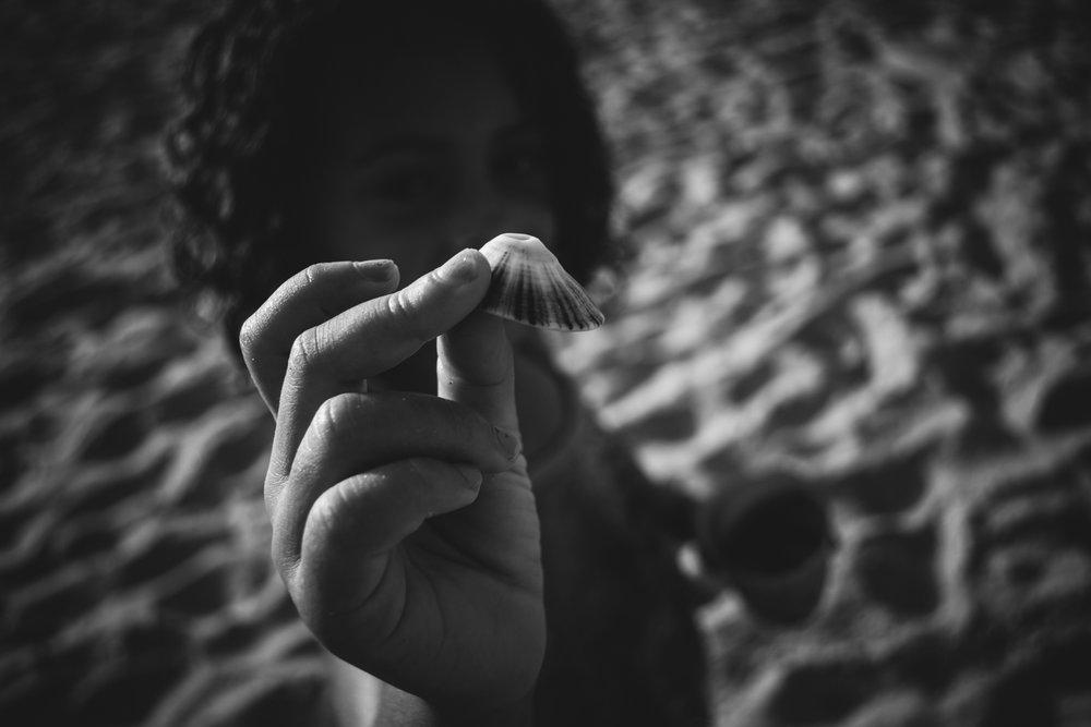girl holding a shell. Alicia Mayorca Photography | Chicago Couple + Maternity + Family Photographer.jpg