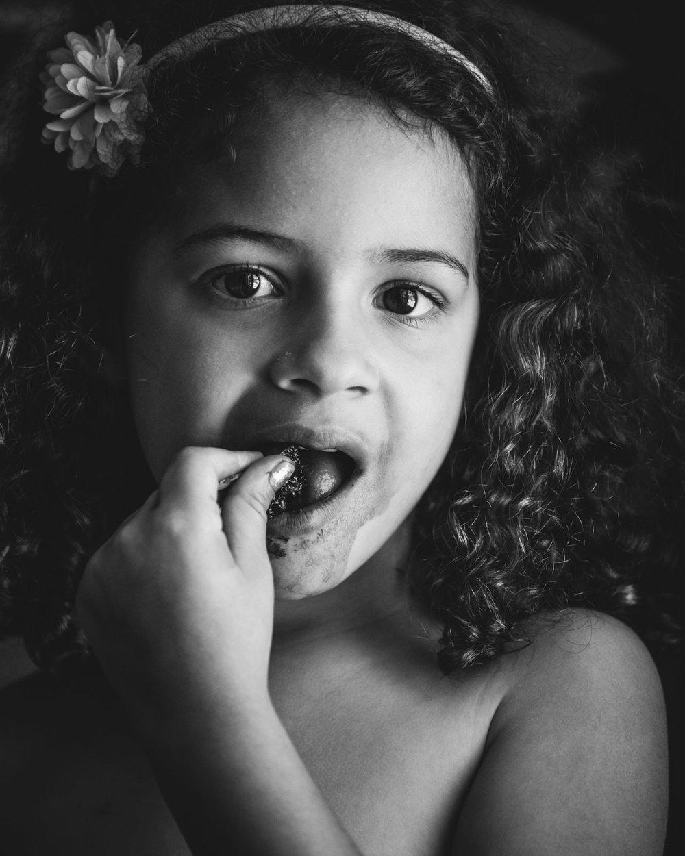 girl's portrait eating cherry. Alicia Mayorca Photography | Chicago Couple + Maternity + Family Photographer.jpg