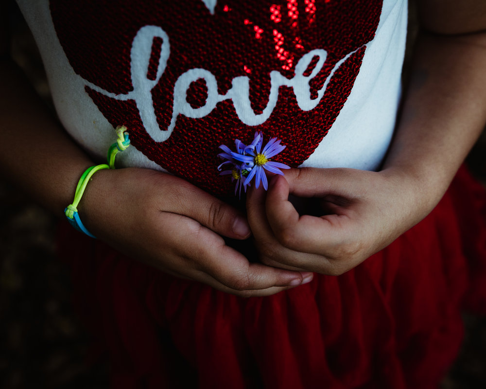 girl holding a flower. Alicia Mayorca Photography | Chicago Couple + Maternity + Family Photographer.jpg