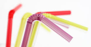 Photo of five different colored bendy plastic straws