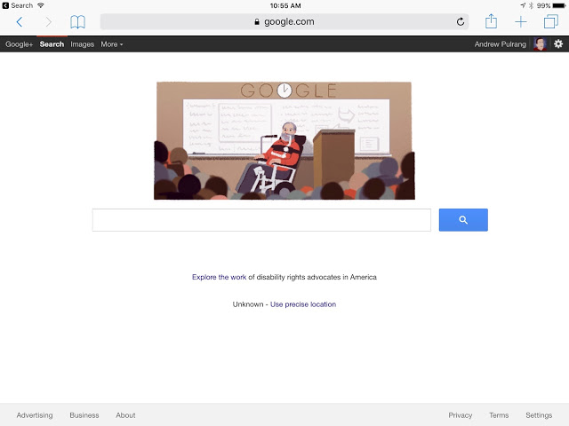 Screen shot of the Google home page, featuring cartoon picture of Ed Roberts, a bearded man in an electric wheelchair and using a breathing machine.