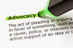 Closeup picture of a definition for the word Advocacy, with a green highlighter pen marking the word