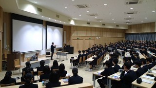 Shunzo plays trumpet at a seminar for students in Northern Japan.