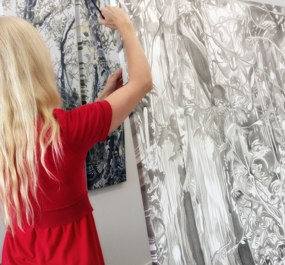 Anne Gudrun painting in studio