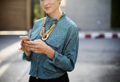 woman holding phone-min (2).jpg