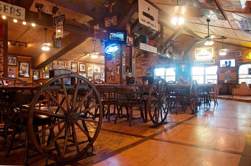 tin-roof-bbq-dining-room-wagon-wheel-tables.jpg