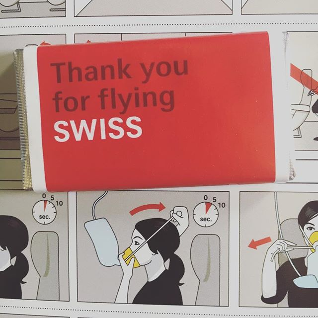 Thank you for flying Swiss air.  Every complimentary chocolate is hand blown through a yellow cup by a brunette for 5 seconds.  Enjoy the sky!