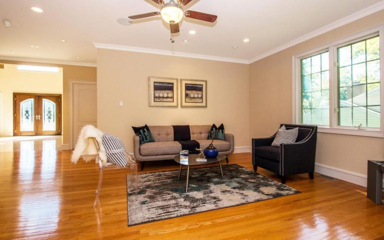 After: Lovely family room with stylish and on trend furniture.