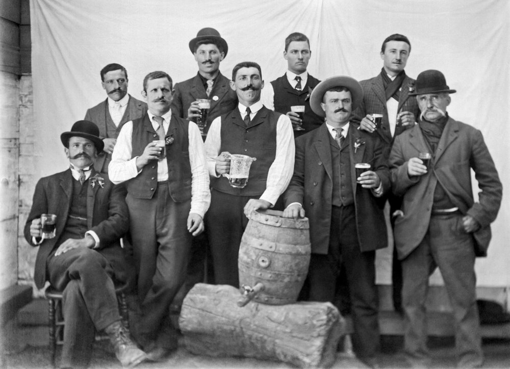 A group of men with full glasses proudly pose with their kid of beer in San Francisco, 1895.  Photo courtesy of  Underwood Archives/Getty Images