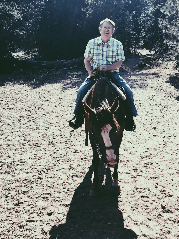 Rob on a mustang in California, Circa 2018