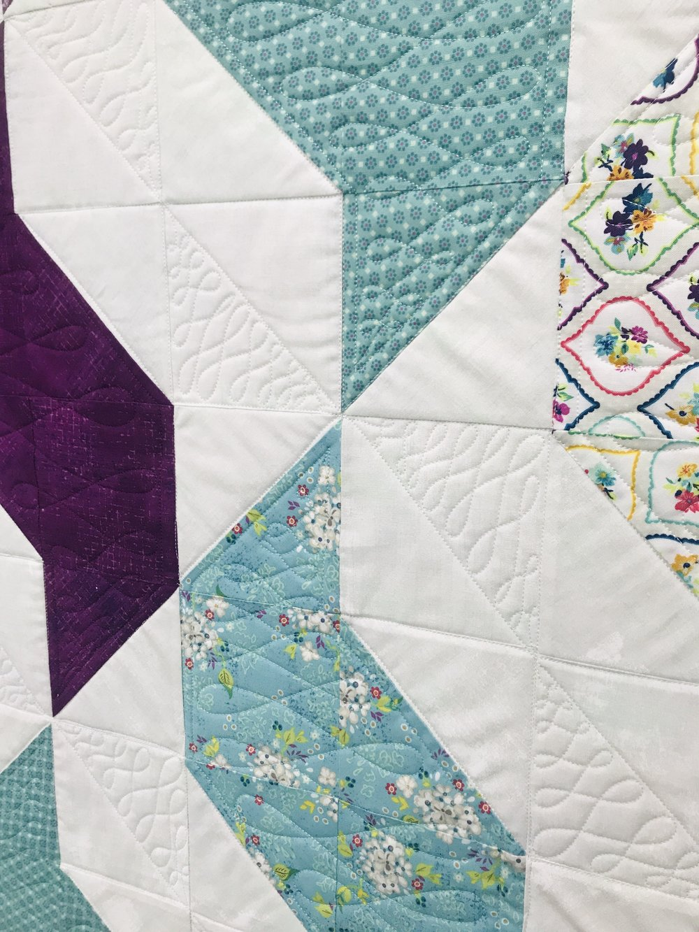 A client quilt with custom quilting