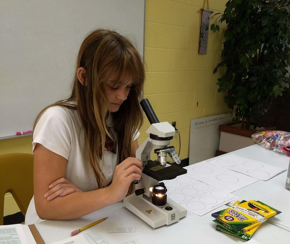 Zoe at Microscope.jpg