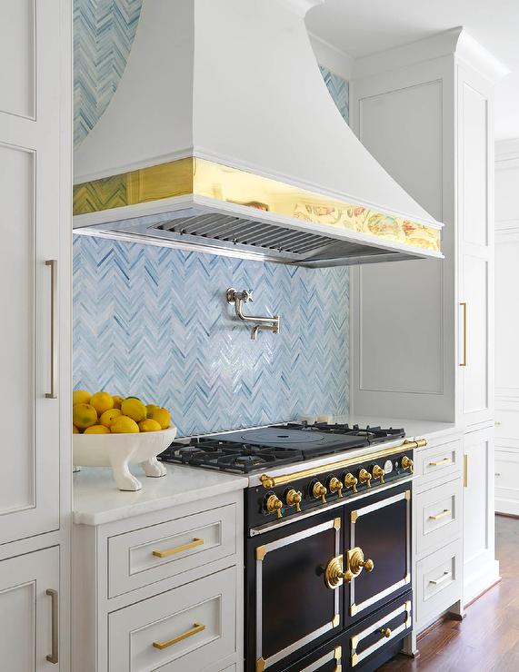 light-gray-range-hood-brass-trim-black-french-stove.jpg