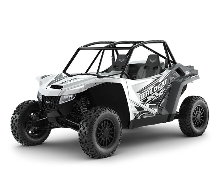 WILDCAT XX   / 2-Passenger  ( $20,699)   18 Inches of Front and Rear Travel  >>  Unequal Length Front A-Arms  >>  Rear Trailing Arm  >>  Premium FOX 2.5 PODIUM QS3 Shocks with Bottom-Out Control  >>  30HP with a 998cc Naturally Aspirated EFI Engine  >>  2WD/4WD with 4WD Lock  >>  14-inch Ground Clearance  >>  Largest-In-Class Cab   WATCH THE VIDEO