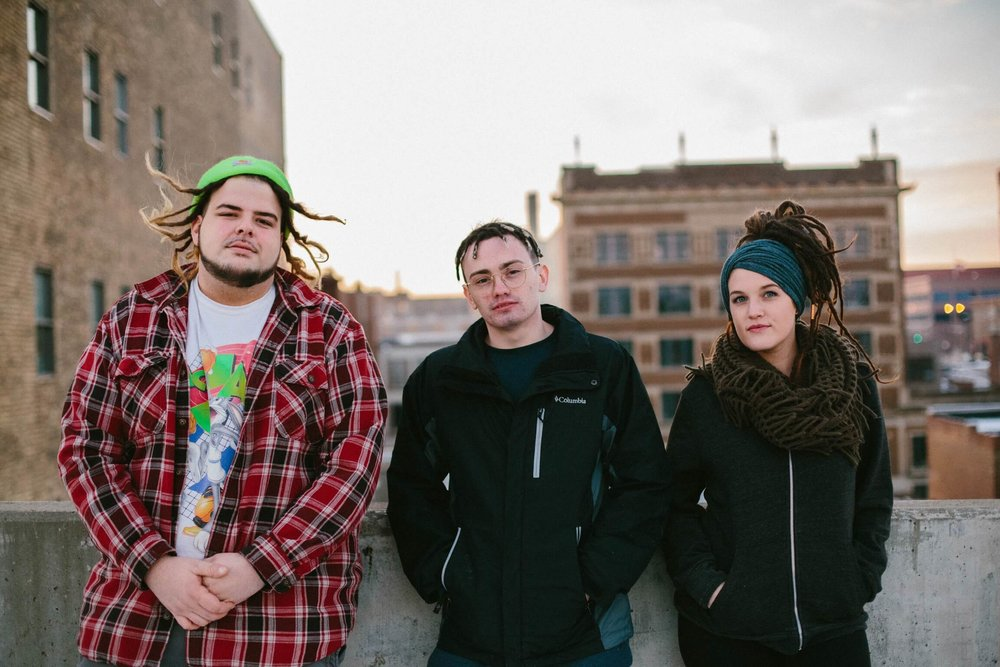 Three people with dreadlocks in Sioux Falls