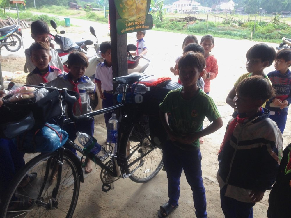 Packing enough water and food before entering the National park. Kids were really interested to check out my packed bike.