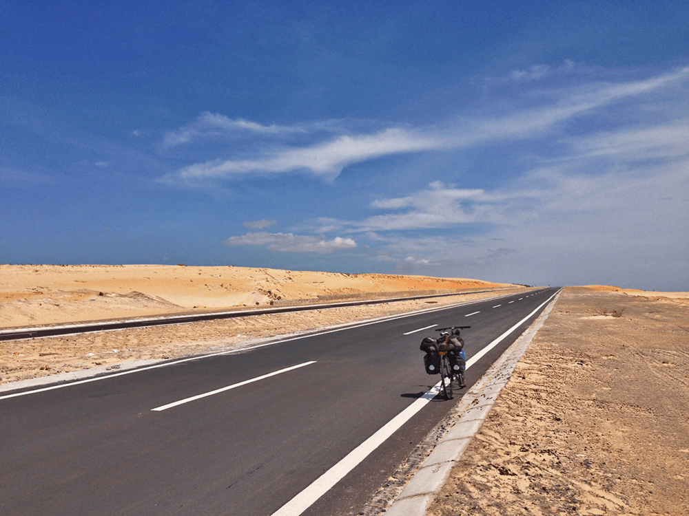 The Sand Dune Highway, Mui Ne to Ca Na: This deserted highway go though some beautiful beach views. The weather was really hot but I was excited to see this continuous landscape along the way, which kept me riding further.
