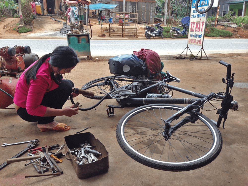 A flat tyre just before Phong Nha, and this lady fixed it very fast.