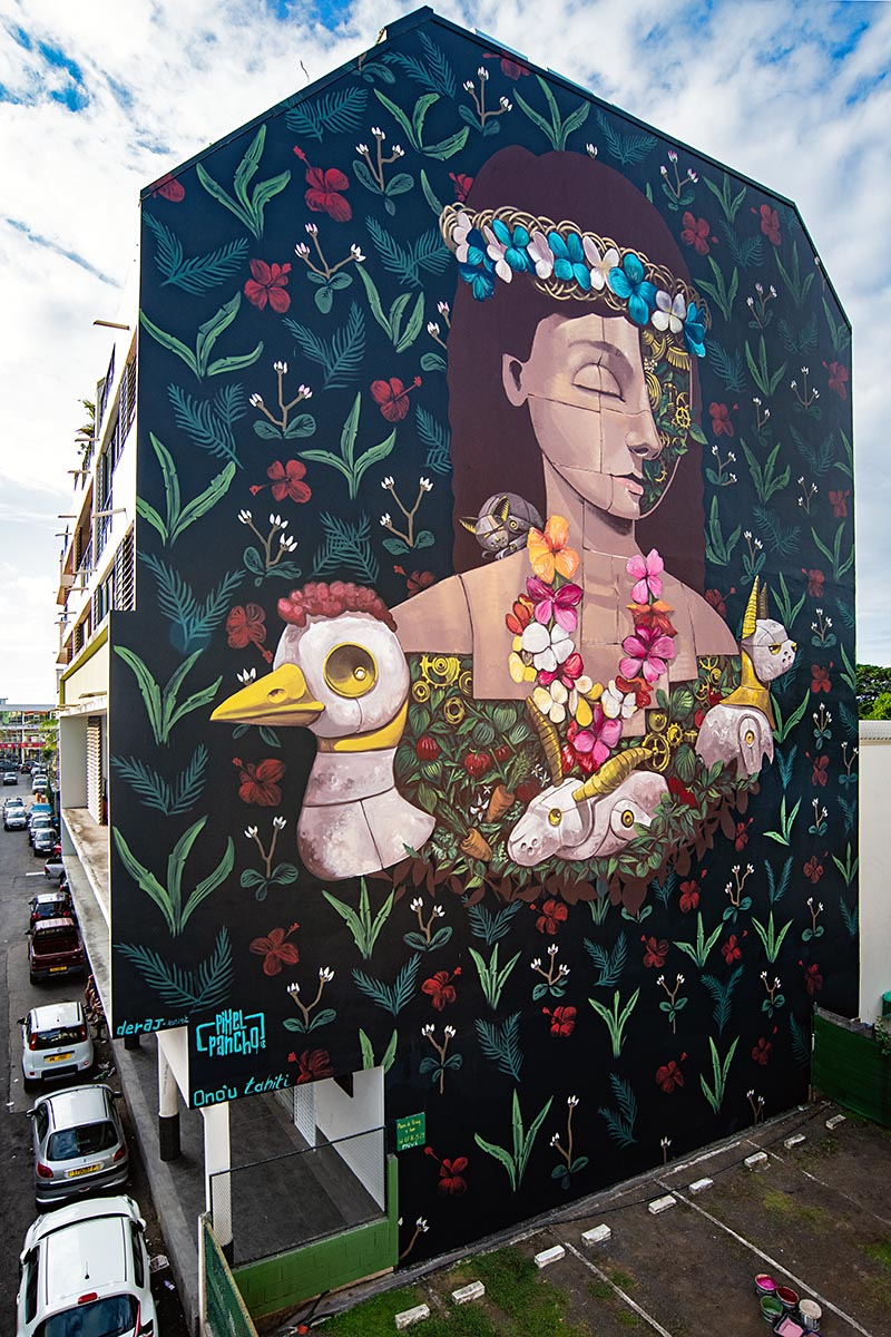 "THAITI (FRENCH POLYNESIA)  "" La jeunesse de Tierry et Diana "" is a tribute, a gift Pixelpancho wanted to give to a woman, Tierry. She lives next the wall he was painting, where she has a small parking lot. But, Tierry, is above all a farmer. Behind the parking, she has her hens and rabbits, and plants from which she derives herbs and vegetables. It's like a secret world, that little farm. And it's our idea of what everyone should do in his life. So, this is Pixel's way to tell her ""thank you"". And Diana? Diana is his beloved cat, who died while he was working.  Ph: Martha Cooper"