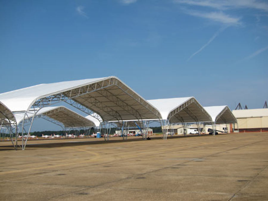 This design was a first for Shelter Structures, a triple wide shelter designed to maximize tarmac space for NAS Meridian. After successful completion of the project in 2006, Shelter Structures was invited back and challenged to provide cover for 54 aircrafts.  Shelter Structures then designed an additional 18 triple wide canopies allowing three aircrafts per structure reducing costs and their footprint on the tarmac.