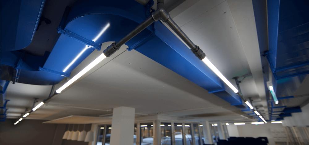 Ladenbau-wasserrohr-baslerpark-installation-licht5.png