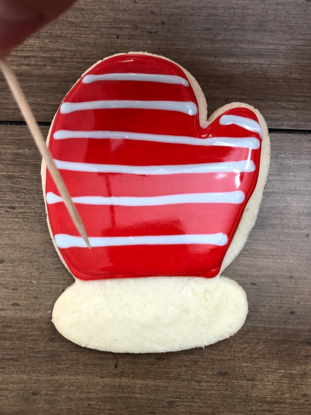 First- outline the cookie and fill it in with your desired color (here I did red). Then immediately make horizontal lines with a different color.