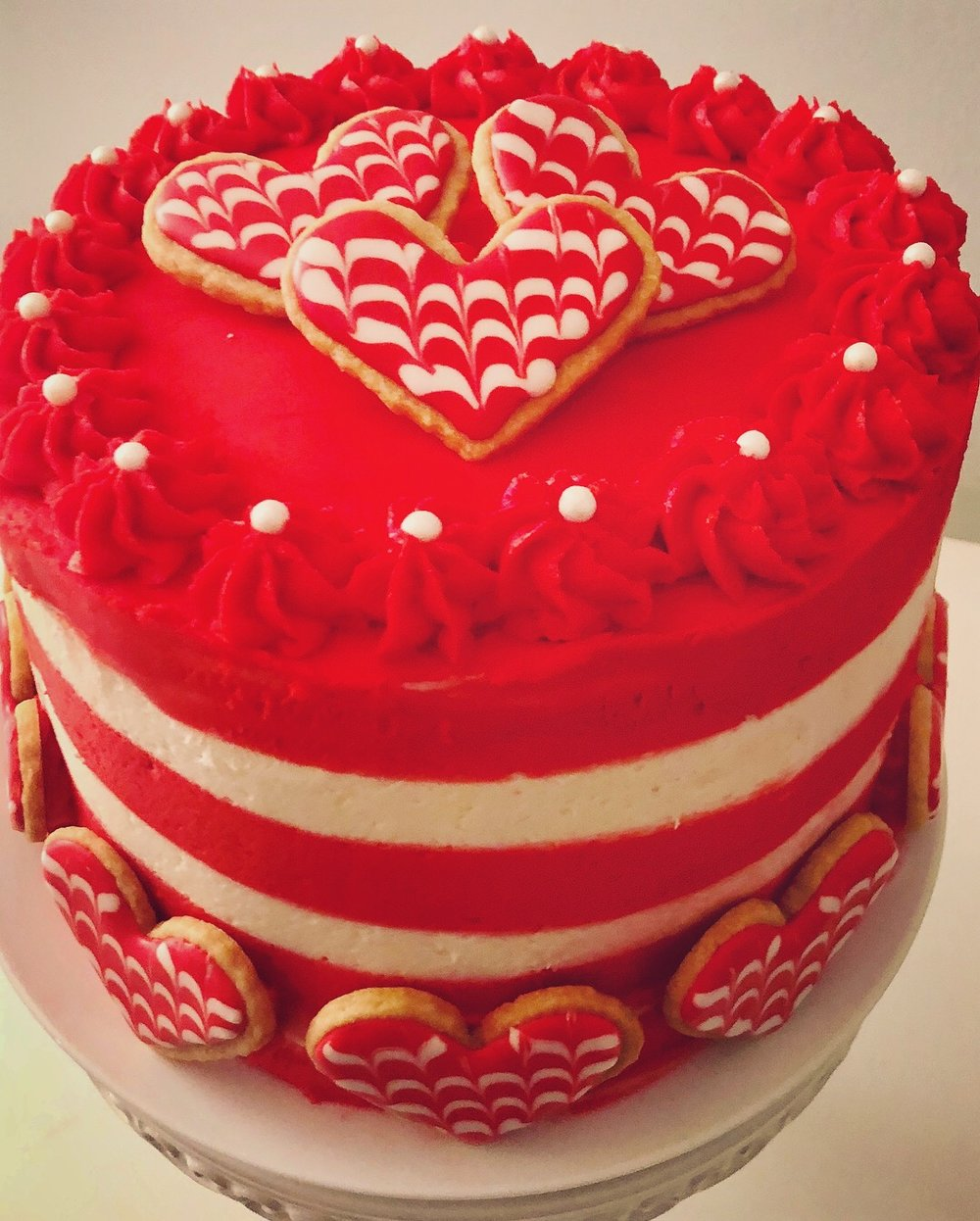 Valentine's Theme Cake   This cake has heart shape cookies around it to celebrate love for Valentine's day.