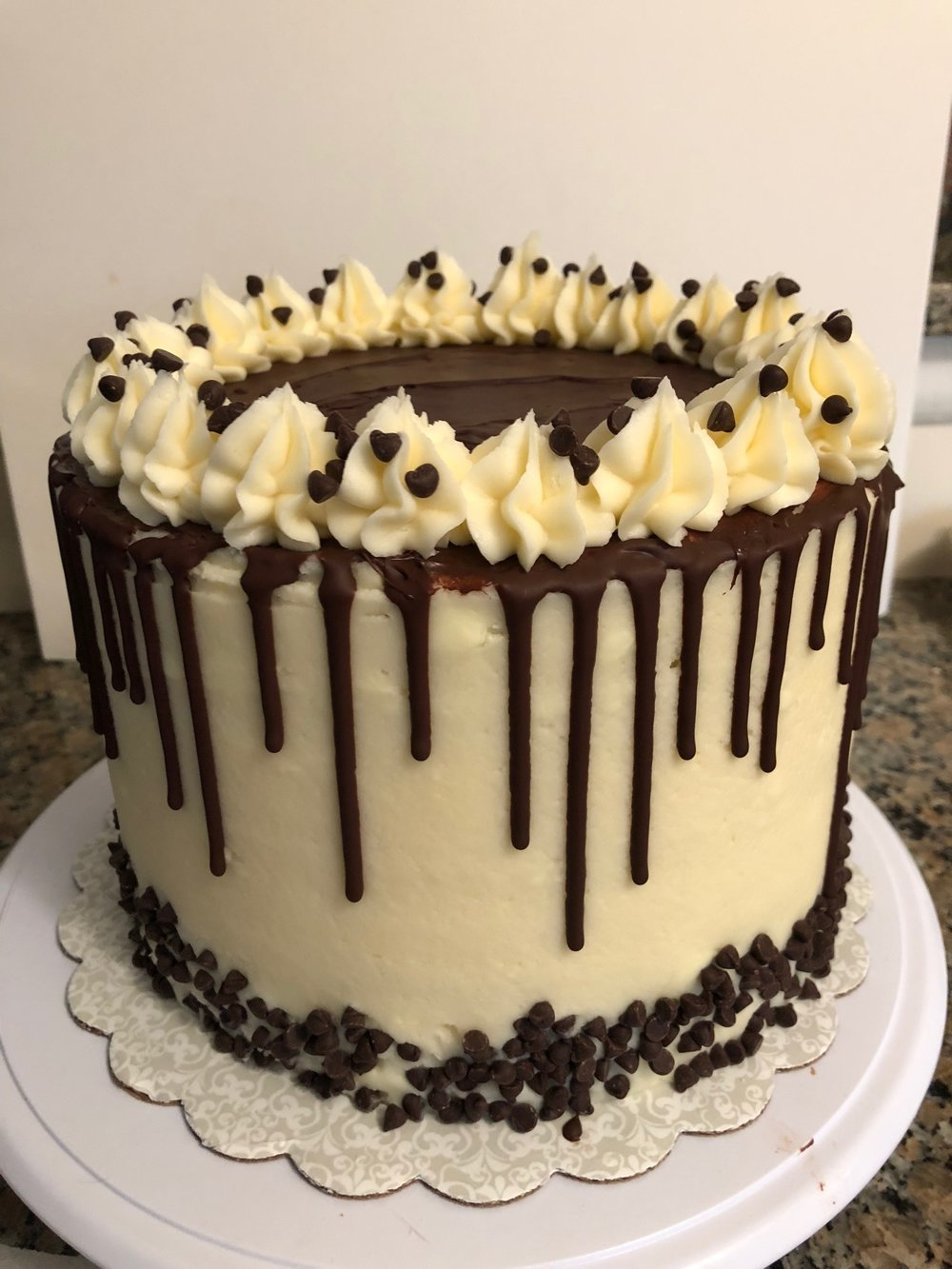 Cannoli Cake   Vanilla or chocolate layers with cannoli filling in between and a chocolate drizzle on the outside of the cake.