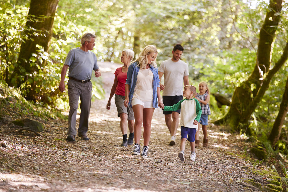 multi-generation-family-enjoying-walk-along-7KQL2ZU.jpg
