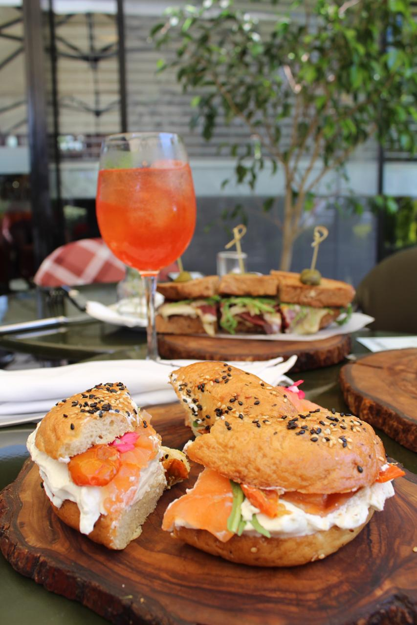 Lox 'n Bagel, parted in 3 for sharing purposes pictured with the Eleanore and pastrami in the background