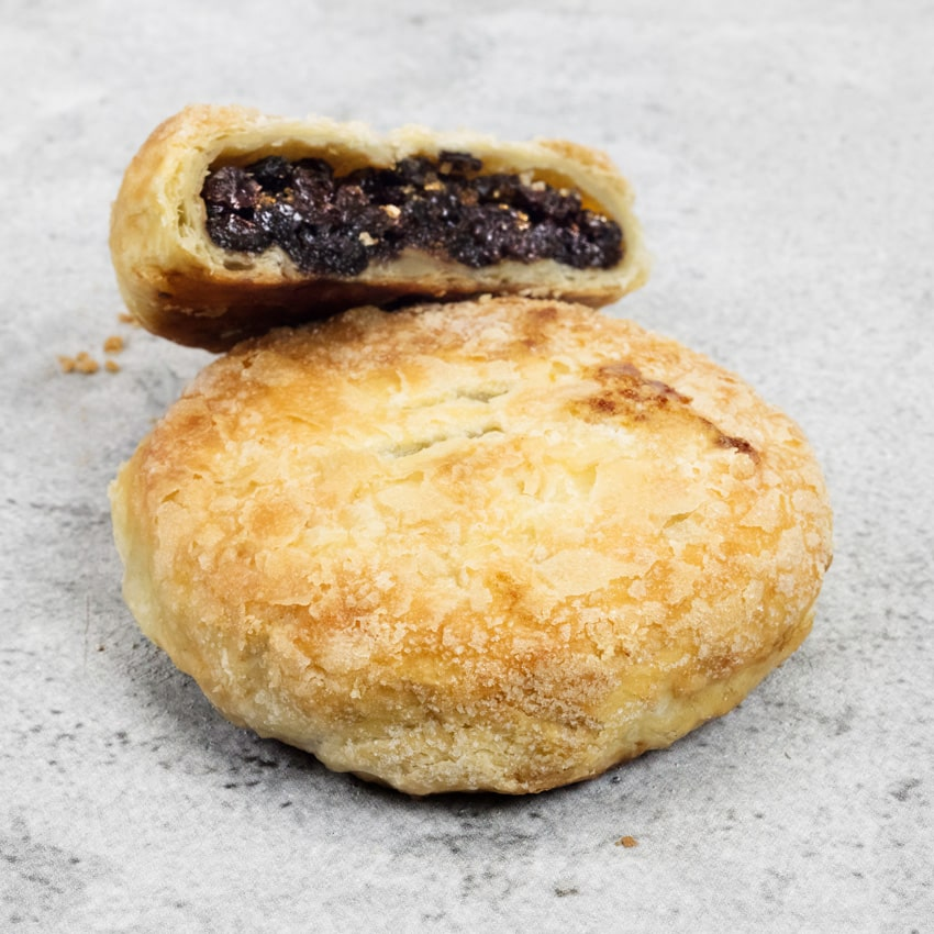 ECCLES CAKE  Handmade using our own puff pastry and stuffed with currants and cane sugar. It is milk washed and then sugared again to make a crispy, gooey delight!