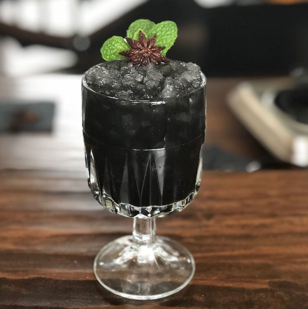 """Today's cocktail special is Tribute to David Bowie, 'The Anise Star'dust ' : Anise, Activated Charcoal, MuckleyEYE East Coast White Rum, Mint, Lime. "" C/O Colts Neck StillHouse Instagram."