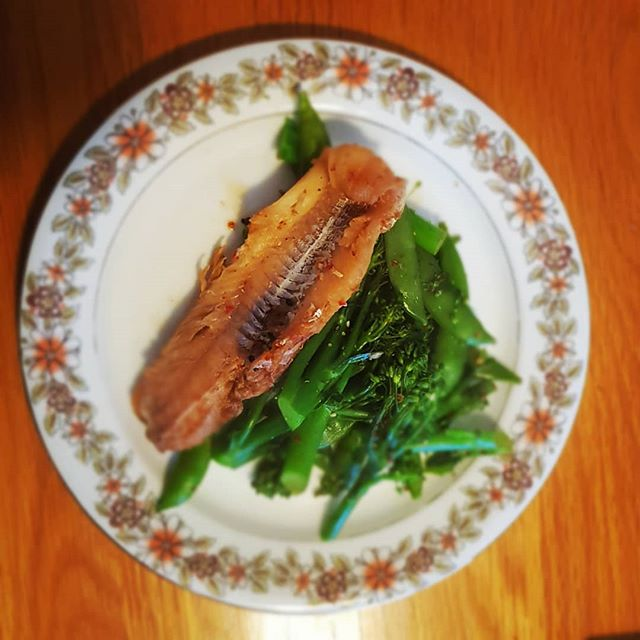 Simple fish with greens tasty and clean marinated in Soy and Ginger.  Very straightforward and low Cal.