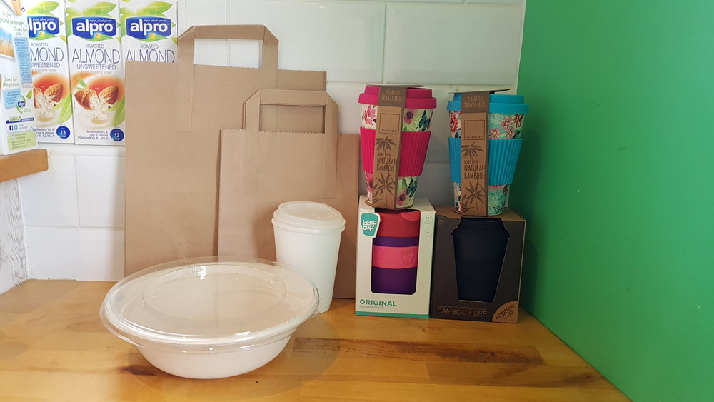 Recycling bags, bowls, compostable cups and reusable cups.