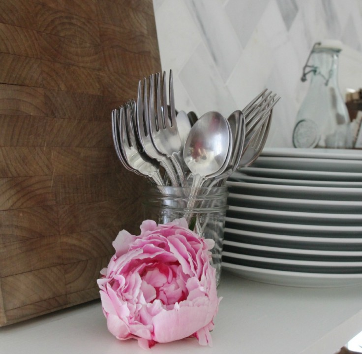 Kitchen Open Shelves Silverware and Flowers