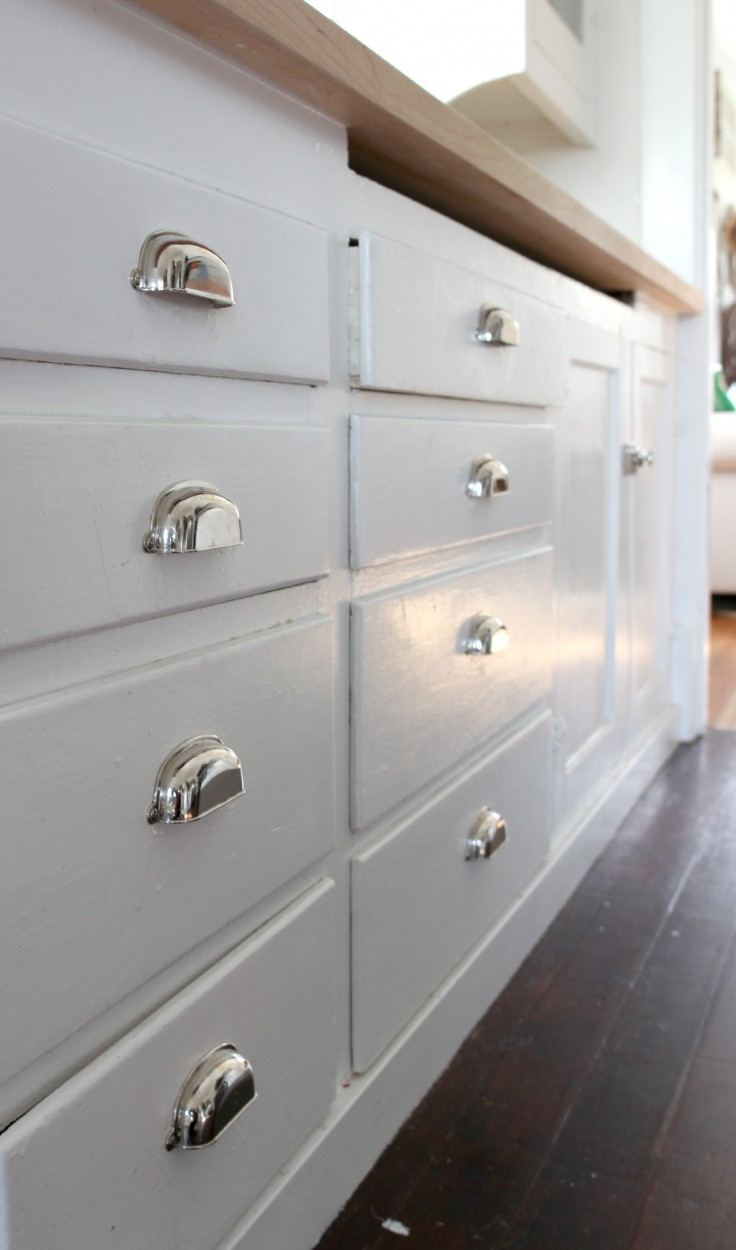 The Grit and Polish  Original 1926 Cabinets with New Clamshell Pulls.jpg