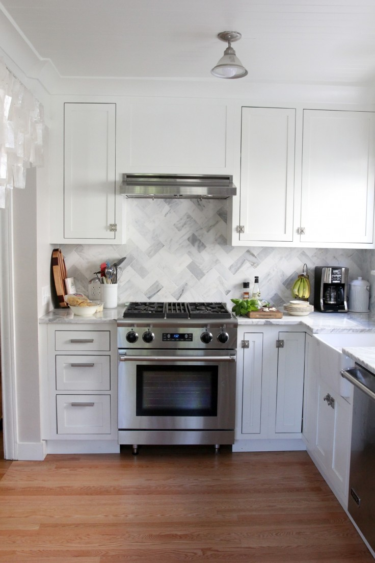 The Grit and Polish - White and Marble Kitchen with Professional Stove