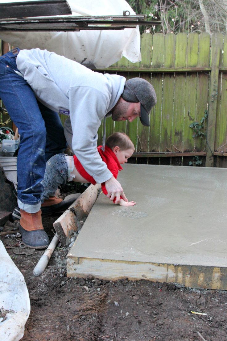 The Grit and Polish - Backyard Shed Handprints in Concrete