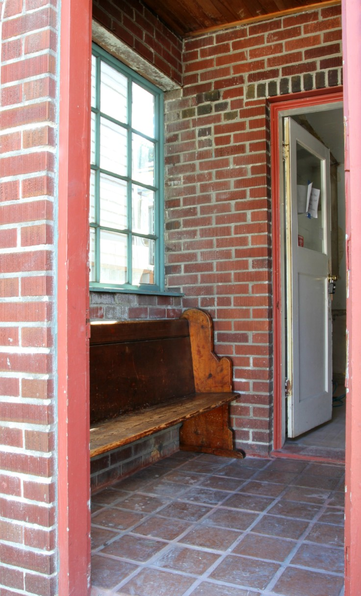 The Grit and Polish - Mudroom old church pew from exterior