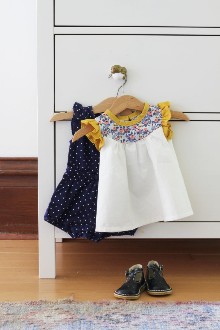 The Grit and Polish - Baby Girl Dresses Hung on Dresser