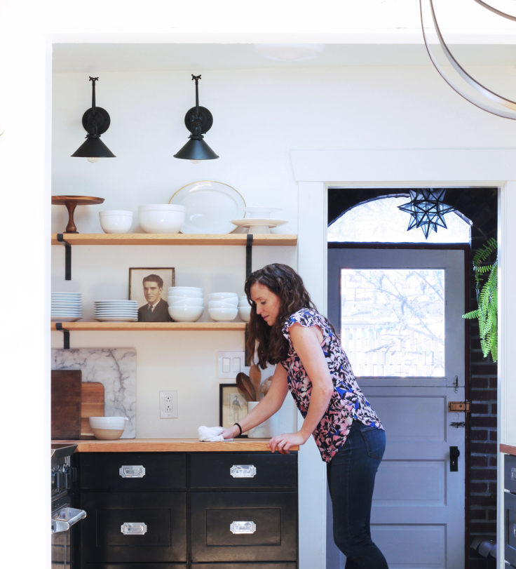 black and white kitchen, black kitchen, two-tone kitchen, open shelves, butcher block, cleaning butcher block