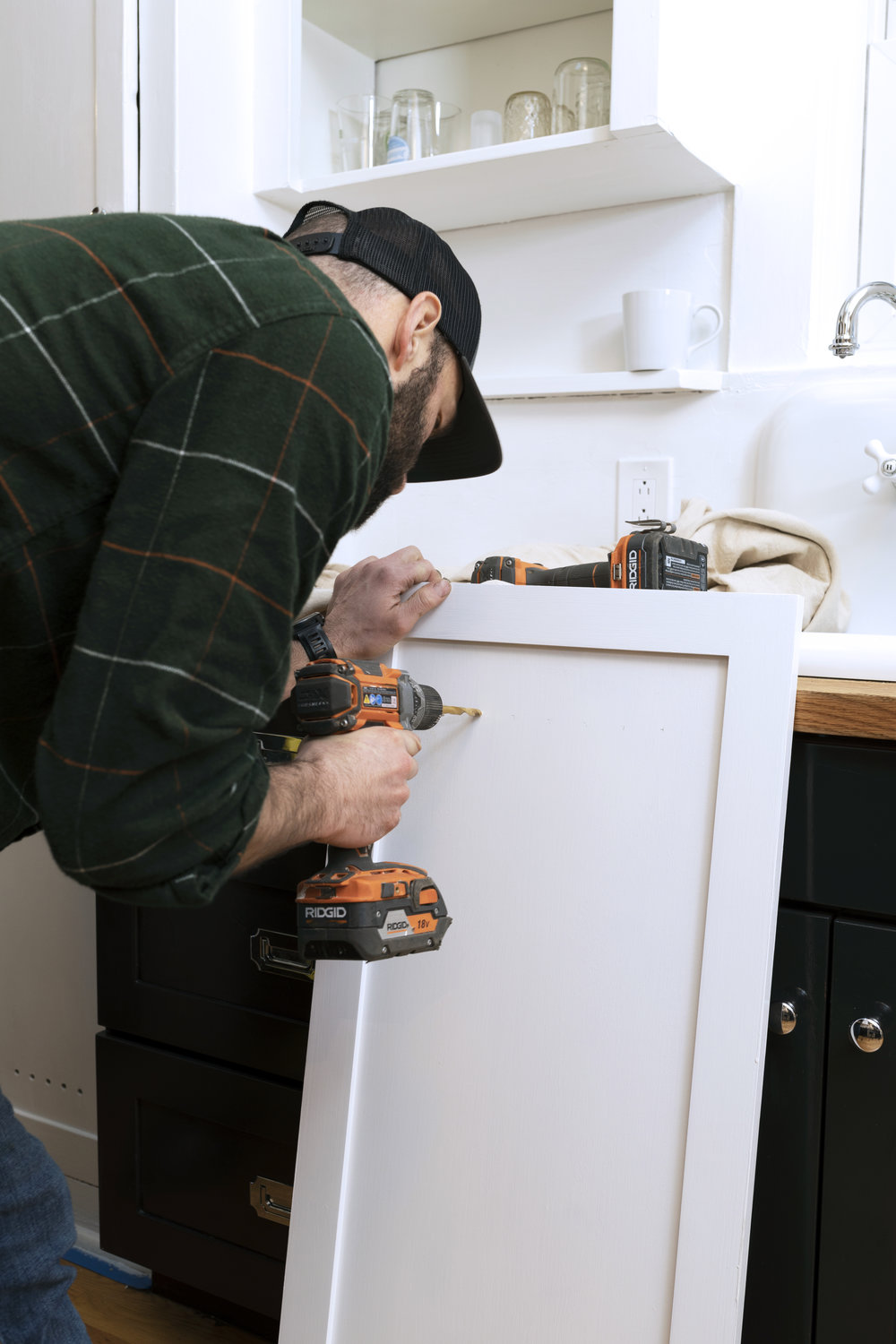 The Grit and Polish - Dexter Kitchen Cabinet Install Drill.jpg